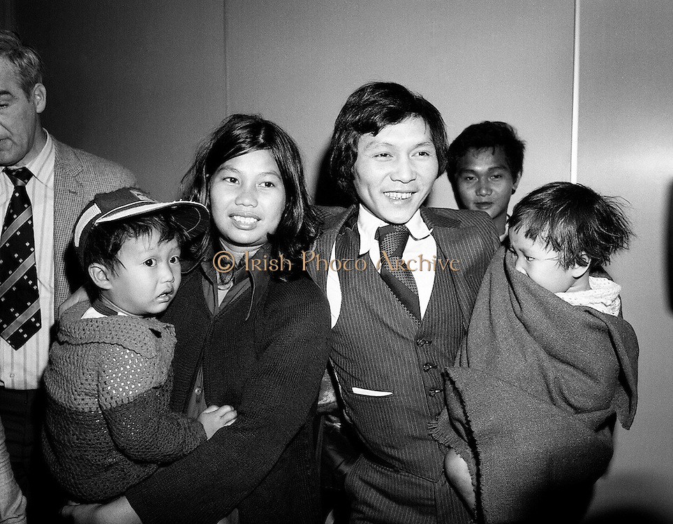As part of a resettlement plan initiated by the United Nations, Ireland agreed to welcome a number of Vietnamese families displaced by the Vietnam war. Here, Mr Nga Van Thai, his wife and two children arrive at Dublin Airport, as part of a group of seventeen who hoped to settle here.<br /> 18 March 1981