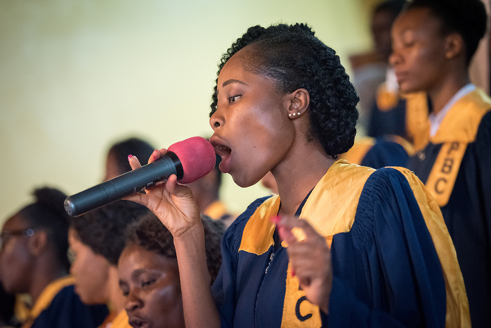 3 November 2019, Monrovia, Liberia: Choir sings during Sunday service at the Providence Baptist Church, also known as 'the cornerstone of the nation', as it was in the Providence Baptist Church that Liberia's declaration of independence was signed. While this Sunday service is taking place in a larger worship space finalized in 1976, the old chapel remains in place adjacent to the new one, and is still in use.