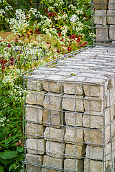 Stone filled gabions and cow parlsey in the Urban Glade Garden.Designer: Paula Ryan - Chelsea 2005