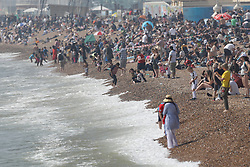 © Licensed to London News Pictures. 22/04/2019. Brighton , UK. Sunbathers crowd on to the beach at Brighton as most of the UK enjoys record breaking high Easter temperatures. Photo credit: Peter Macdiarmid/LNP