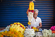 Selling flowers by a temple at at market in Munnar, Western Ghats Mountains, Kerala, India