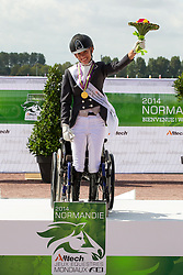 Rixt van der Horst and Uniek World Champion in the Freestyle Grade II Para Dressage - Alltech FEI World Equestrian Games™ 2014 - Normandy, France.<br /> © Hippo Foto Team - Leanjo de Koster<br /> 25/06/14