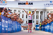 Top female finisher Britta Martin of New Zealand makes her way to the finish line during 2014 Ironman Wisconsin triathlon Sept. 7, 2014. (Photo © Andy Manis)