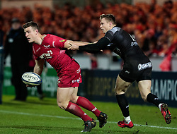 Scarlets' Scott Williams is tackled by Toulon's Chris Ashton<br /> <br /> Photographer Simon King/Replay Images<br /> <br /> European Rugby Champions Cup Round 6 - Scarlets v Toulon - Saturday 20th January 2018 - Parc Y Scarlets - Llanelli<br /> <br /> World Copyright © Replay Images . All rights reserved. info@replayimages.co.uk - http://replayimages.co.uk