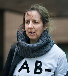 "© Licensed to London News Pictures. 29/01/2016. London, UK. JOSEPHINE HERIVEL wearing a t-shirt with the words ""A B - FRAMED BY BRITISH STATE""  written on it as she leaves Southwark Crown Court in London where Maoist cult leader Aravindan Balakrishnan has been sentenced to 23 years in prison for rape, child cruelty and false imprisonment. Aravindan Balakrishnan was found guilty of the rape of two of his followers and and false imprisonment of  his daughter for more than 30 years in a commune in south London.  Photo credit: Peter Macdiarmid/LNP"