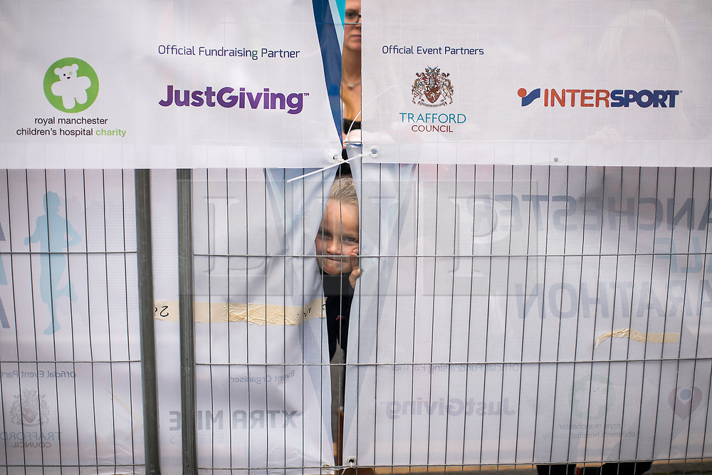 © Licensed to London News Pictures . 15/10/2017 . Manchester , UK . Friends and families wait for athletes at the finish line in the Greater Manchester Half Marathon in Old Trafford . Photo credit : Joel Goodman/LNP