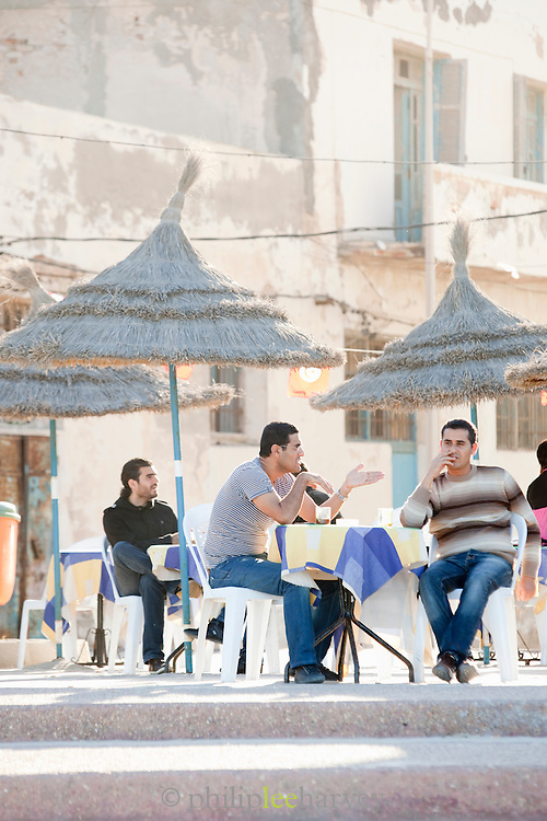 People at a cafe in the old medina in Sousse, an UNESCO World Heritage Site, Tunisia