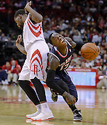 Nov 27, 2013; Houston, TX, USA; Atlanta Hawks point guard Dennis Schroder (17) draws a foul on Houston Rockets point guard Aaron Brooks (0) during the fourth quarter at Toyota Center. The Rockets won 113-84. Mandatory Credit: Thomas Campbell-USA TODAY Sports