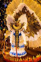 Performers on floats in the Carnaval parade of Unidos de Vila Isabel samba school in the Sambadrome, Rio de Janeiro, Brazil.