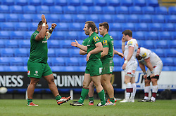 London Irish replacement (#21) Tomas O'Leary celebrates the win with London Irish replacement (#18) Halani Aulika- Photo mandatory by-line: Dougie Allward/JMP - Mobile: 07966 386802 - 12/04/2015 - SPORT - Rugby - Reading - Madejski Stadium - London Irish v Sale Sharks - Aviva Premiership