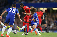 David Luiz of Chelsea tackles Divock Origi of Liverpool. Premier league match, Chelsea v Liverpool at Stamford Bridge in London on Friday 16th September 2016.<br /> pic by John Patrick Fletcher, Andrew Orchard sports photography.