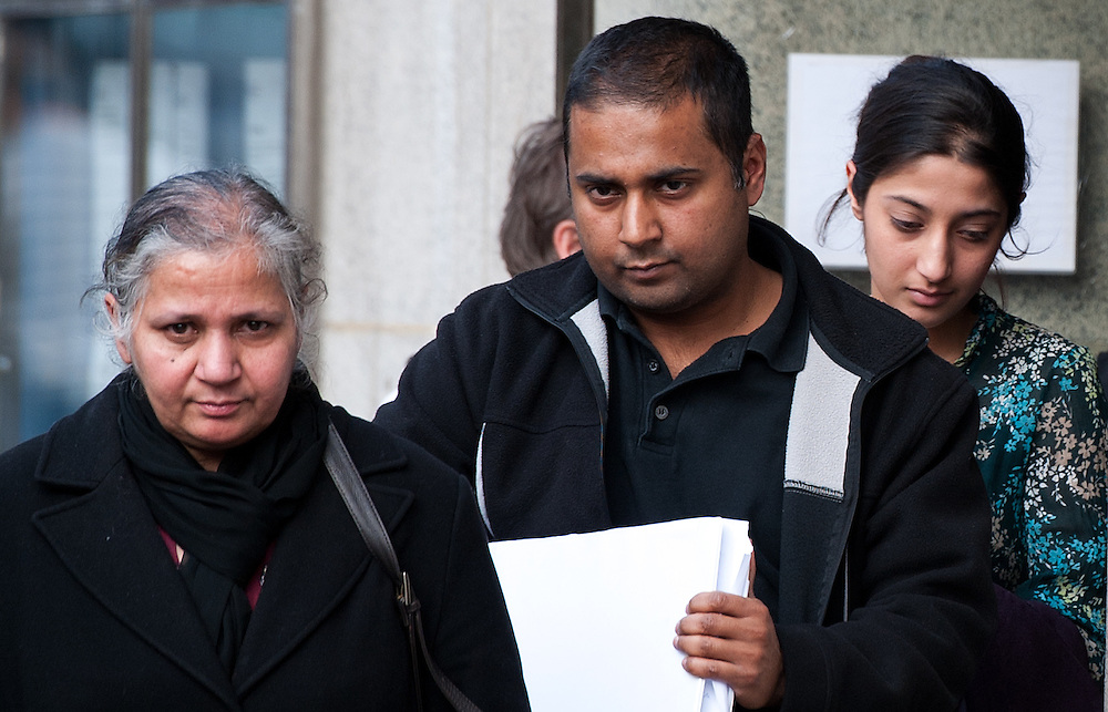 Mundill Mahil (R)leaves the Old Bailey surrounded by family  after being found guilty of GBH with intent  on February 24th 2012..Student Mahil will be sentenced for her part for the death of Gagandip Singh, 21, after he was beaten, put in a car, driven to London and set on fire..Mahil will be sentenced on Wednesday 29th at The Old Bailey..Photo Ki Price..