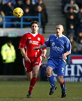 Photo: Chris Ratcliffe.<br />Gillingham v Bristol City. Coca Cola League 1. 26/12/2005.<br />Andrew Crofts (R) of Gillingham and Cole Skuse of Bristol City chase the ball down.