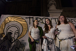 © licensed to London News Pictures. London, UK 14/10/2012. Occupy London protesters, who chained themselves to St Paul's Church, posing outside the church after leaving voluntarily, after nearly seven hours of negotiations with Dean of St Paul's. Names: (left to right) Tammy Samede, Alison Ramford, Siobhan Grimes. Photo credit: Tolga Akmen/LNP