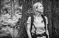 A portrait of a Caucasian woman in front of a large tree in the forest, Little Si trail, Washington.