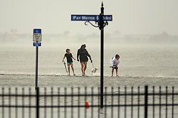 October 8, 2016 - St. Augustine, Florida, U.S. - DOUGLAS R. CLIFFORD   |   Times.A family traverses a seawall on Friday (10/7/16) next to the Castillo de San Marcos, the oldest masonry fort in the continental United States. The area became flooded as hurricane Matthew passed the historic city of St. Augustine on Florida's east coast. (Credit Image: © Douglas R. Clifford/Tampa Bay Times via ZUMA Wire)