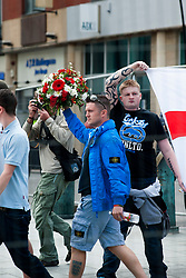 EDL return to Sheffield to lay flowers at Sheffield War Memorial<br /> <br /> 12:53 The English Defence League leader Tommy Robinson strides into Barkers Pool holding up his floral tribute<br /> <br /> 8 June 2013<br /> Image © Paul David Drabble<br /> www.pauldaviddrabble.co.uk