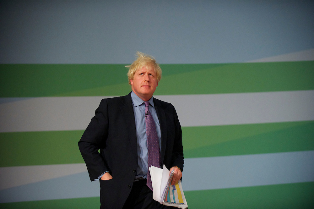 London Mayor Boris Johnson takes the stage to address delegates on the second day of the Conservatives Party Conference at the ICC, Birmingham, UK on October 4, 2010.  This is the first conference since the government coalition with the Liberal Democrats.