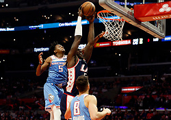 January 27, 2019 - Los Angeles, CA, U.S. - LOS ANGELES, CA - JANUARY 27: Los Angeles Clippers center Montrezl Harrell (5) goes up for a dunk past Sacramento Kings guard De'Aaron Fox (5) and Sacramento Kings guard Bogdan Bogdanovic (8) during the game on January 27, 2019, at Staples Center in Los Angeles, CA. (Photo by Adam  Davis/Icon Sportswire) (Credit Image: © Adam Davis/Icon SMI via ZUMA Press)
