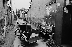 Luggage on bicycle outside house being demolished in Beijing hutong