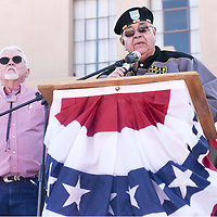 David Cuellar, right, of Veterans Helping Veterans, honors Gallup Mayor Jackie McKinney, who was selected as grand marshal, during a Veterans Day celebration at the Downtown Courthouse Plaza in Gallup Nov. 11, 2019.<br /> <br /> Richard Reyes/Independent