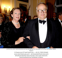 LORD & LADY BIRDWOOD at a reception in London on 2nd October 2002.<br />PDS 9