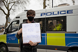 © Licensed to London News Pictures. 14/03/2021. London, UK. A protesters holds outside New Scotland Yard ahead of protest against the Police, Crime, Sentencing and Courts Bill 2021 that if passed will introduce new restrictions on protest. This demonstration comes after police arrested attendees at a vigil for Sarah Everard on Clapham Common last night.  Photo credit: George Cracknell Wright/LNP