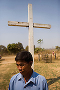 KHMER ROUGE CHRISTIANS. South East Asia, Cambodia, Pailin. Several high ranking ex Khmer Rouge officials including the notorious former Khmer Rouge prison chief Kaing Khek Lev, also known as Duch, have sympathies towards Christianity and Evangelism. Some have changed religion or even become Evangelist priests and pasteurs. Ex-Khmer Rouge buddhists have something to fear: Buddhism offers neither redemption or forgiveness; the Karma and the next life are affected by the present one. On the other hand, Christianity and Evangelism allow one to be born again, it forgives our sins and offers redemption. This proposition is far more attractive to those who orchestrated, organised and carried out mass murder, and torture on a grand scale, against the Cambodian people, leaving 2 million dead in the 1970's. American priests are working in Khmer Rouge strongholds, bringing their Evanglist message, and are having some success. Approved rules for UN-backed Khmer Rouge genocide trials are now in place. The highest ranking Duch is in prison, in Phnom Penh, ready to be tried. What role the Evangelists will play in this scenario is yet to be seen.///Ex-Khmer Rouge Evangelist christian pasteurs
