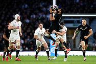 New Zealand's Patrick Tuipulotu gathers and is tackled by England's Tom Wood - QBE Autumn Internationals - England vs New Zealand - Twickenham Stadium - London - 08/11/2014 - Pic Charlie Forgham-Bailey/Sportimage