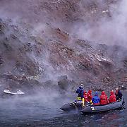Antarctica, Zodiac shuttles tourists to Bellingshausen Island. South Sandwich Island chain.