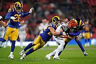 Cincinnati Bengals Wide receiver Alex Erickson (12) is tackled by LA Rams Defensive back Taylor Rapp (24) and LA Rams Defensive back Jalen Ramsey (20) during the International Series match between Los Angeles Rams and Cincinnati Bengals at Wembley Stadium, London, England on 27 October 2019.