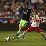 Dax McCarty, (right), New York Red Bulls, challenges Andy Rose, Seattle Sounders  during the New York Red Bulls Vs Seattle Sounders, Major League Soccer regular season match at Red Bull Arena, Harrison, New Jersey. USA. 20th September 2014. Photo Tim Clayton