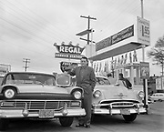 8609-A75.  This man has just won the television as a prize at Regal Gas, 3th & Powell, Portland, Oregon. April 9, 1957.