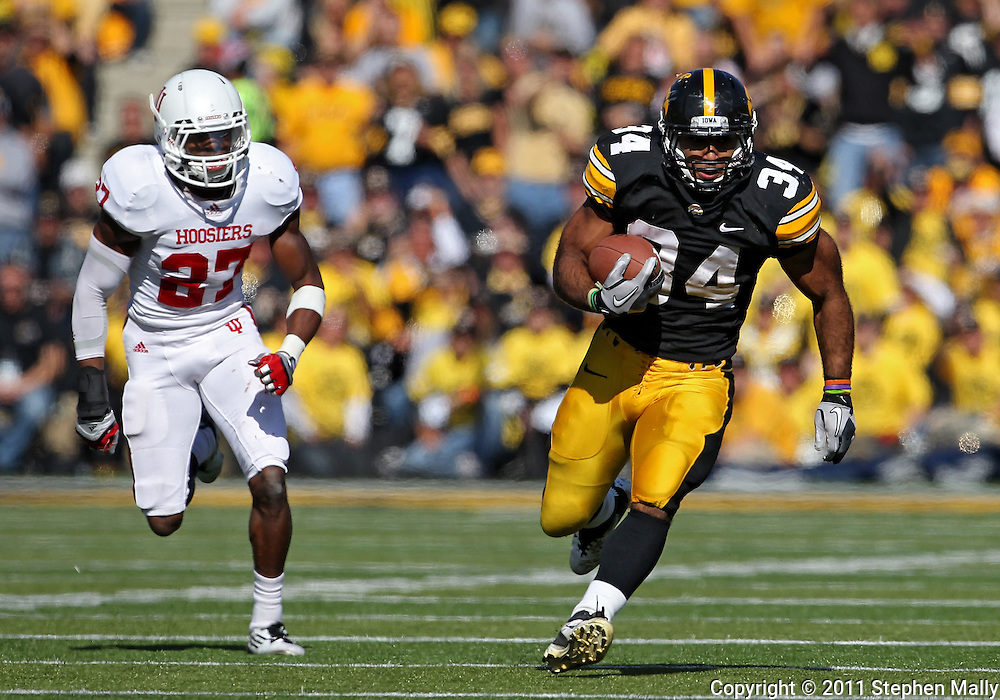 October 22, 2011: Iowa Hawkeyes running back Marcus Coker (34) on a run as Indiana Hoosiers defensive back Alexander Webb (27) chases during the first half of the NCAA football game between the Indiana Hoosiers and the Iowa Hawkeyes at Kinnick Stadium in Iowa City, Iowa on Saturday, October 22, 2011. Iowa defeated Indiana 45-24.