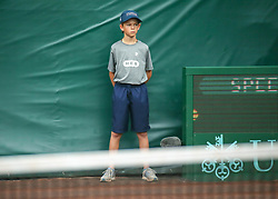April 13, 2018 - Houston, TX, U.S. - HOUSTON, TX - APRIL 13:  Ball boy stands by during the Quarterfinal round of the Men's Clay Court Championship on April 13, 2018 at River Oaks Country Club in Houston, Texas.  (Photo by Leslie Plaza Johnson/Icon Sportswire) (Credit Image: © Leslie Plaza Johnson/Icon SMI via ZUMA Press)