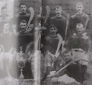 "Kilkenny (Tullaroan) All-Ireland Hurling Champions 1904. Back Row: Dick Brennan, ""Drug"" Walsh, Eddie Doyle, Paddy ""Icy"" Lanigan, John James Brennan, Martin Lalor, Jack Hoyne. Front Row: Jim Dunne, Sim Walton, Pat Fielding, Dan Stapleton, Ger Doheny (capt), Jim Lalor, Jack Rochfort, Pat ""Fox"" Maher. Foreground: Dick Doyle, Paddy Saunders, J J Brennan and Jim Dunne stood in for Fr Dan Grace and Jack Anthony who had played in final but were not available when the photo was taken."
