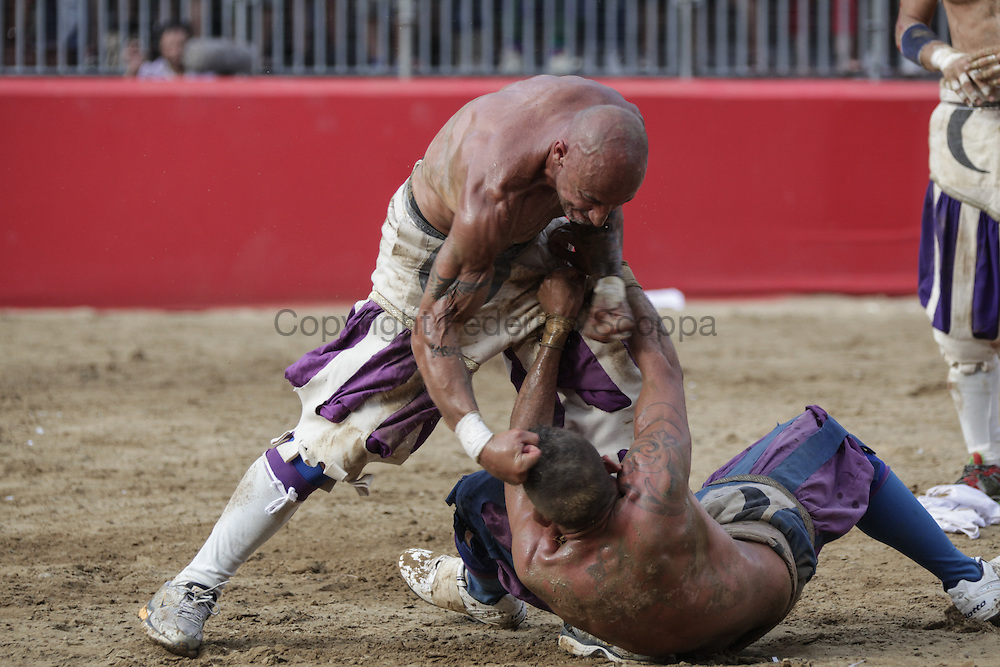 A player hitting an opponent on the head