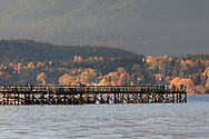 View of the pier at Rocky Point Park in Port Moody, British Columbia, Canada.  The water surrounding the pier is Burrard Inlet.