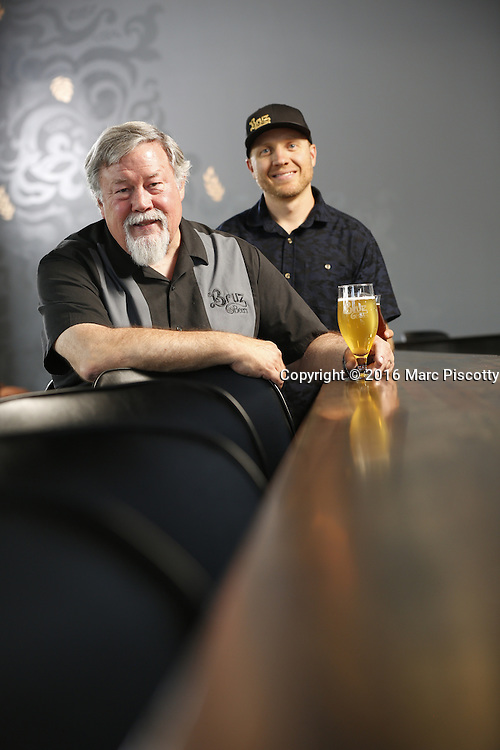 SHOT 7/22/16 2:01:57 PM - Bruz Beers co-founders Charlie Gottenkieny and Ryan Evans inside the new brewery near 67th Avenue and Pecos in Denver, Co. Bruz Beers is Denver's artisanal Belgian-style brewery, featuring a full line of traditional and Belgian-inspired brews, hand-crafted in small batches. Includes images of Evan's dog 'Cooper' as well who serves as the brewery dog. (Photo by Marc Piscotty / © 2016)