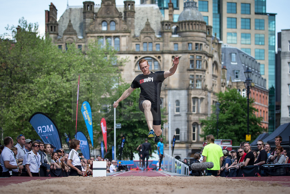 © Licensed to London News Pictures . 17/05/2014 . Manchester , UK . GREG RUTHERFORD warming up . The Great City Games in Manchester , with athletics on a track along Deansgate and Pole Vault and Long Jump in Albert Square . Photo credit : Joel Goodman/LNP
