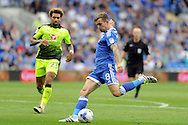 Cardiff City's Joe Ralls (blue) shoots at goal. EFL Skybet championship match, Cardiff city v Reading at the Cardiff city stadium in Cardiff, South Wales on Saturday 27th August 2016.<br /> pic by Carl Robertson, Andrew Orchard sports photography.
