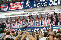 HONG KONG, HONG KONG : Fiji players celebrate after defeating Wales 26-19, to defend their Hong Kong Rugby Sevens title in a very dramatic way - coming back from a half time deficit of 19-0, shown in Hong Kong on Sunday, 24 March, 2013.
