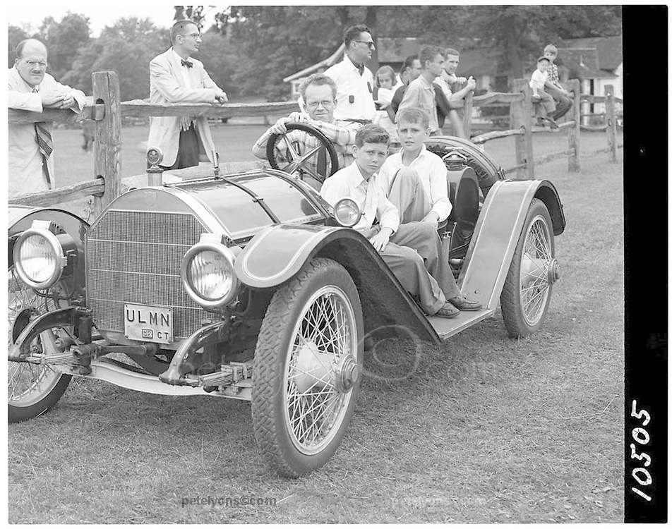 Writer Ken Purdy aboard his Mercer Raceabout with two unidentified boys. Date and venue unknownk but this is likely the day Purdy gave young Pete Lyons a ride in this car, remembered as a short oval course somewhere in Connecticut (This is 4x5 neg no. 10505); Photo by Ozzie Lyons 195x/ © 2016 Pete Lyons / petelyons.com