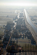 Nederland, Noord-Holland, Watergang, 10-01-2009; klassiek winters tafereel, dorpje met dorpskerk en boerderijen in Waterland, gelegen aan het aan het Noordhollandsch Kanaal, winter landschap in tegenlicht, het kanaal is bevroren; classic winter scene small town with village church and farms Waterland, situated at the North Holland Canal, winter landscape taken against the light, the channel is frozen;.ijs, ijspret, natuurijs, winter, koud, vriezen, min nul, beneden nul, koud, celsius, ice, natural ice, cold, freezing, minus zero, below zero, cold, winterlandschap, winter landscape;.Noordholland Kanaal, Noord-Hollands Kanaal, . .luchtfoto (toeslag); aerial photo (additional fee required); .foto Siebe Swart / photo Siebe Swart /photo Siebe Swart