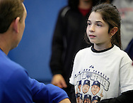 Chester, New York - A young softball player listens to Former New York Mets baseball all-star player Howard Johnson during a cliinic on hitting at the first anniversary open house celebration at The Rock Sports Park on Nov. 12, 2011.