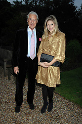 MARTIN SUMMERS and his daughter TARA SUMMERS at the annual Cartier Chelsea Flower Show dinner held at the Chelsea Physic Garden on 21st May 2007.<br />