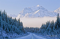 Icefields Parkway and Mt Temple after a fresh snowfall, Banff National Park, Alberta, Canada (may be edited to remove blue, though original is blue like this)