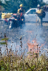 Fire specialists monitoring prescribed burn on the Blackland Prairie at Clymer Meadow Preserve, Texas Nature Conservancy, Greenville, Texas, USA.