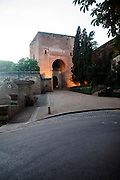 Night time illuminated view of the Puerta de la Justicia, Gate of Justice, entrance tower to the Alhambra, Granada, Spain
