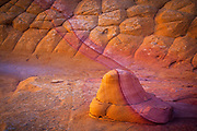 "Sandstone ""snail"" against a sandstone wall in the South Coyote Buttes unit of the Vermillion Cliffs National Monument"